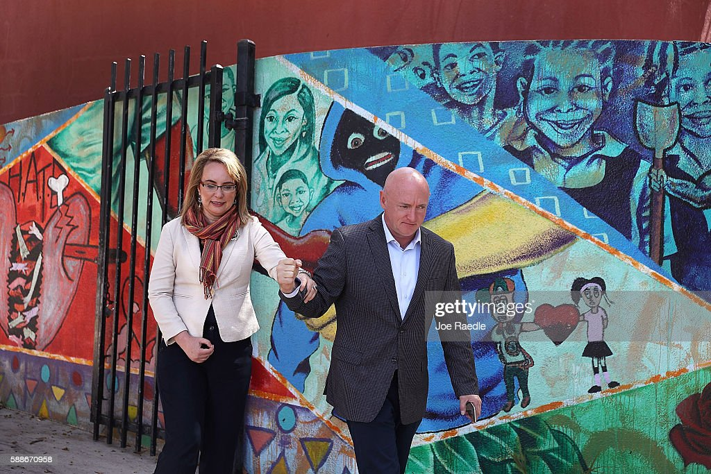 Former Rep Gabrielle Giffords walks with her husband retired NASA astronaut Mark Kelly after joining with antigun violence activists and victims'...