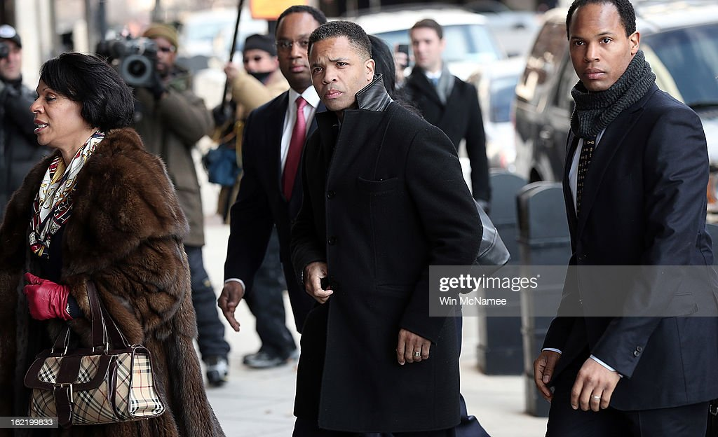 Former Rep. Jesse Jackson Jr. (C) enters U.S. District Court February 20, 2013 in Washington, DC. Jackson and his wife, Sandi Jackson, are expected to plead guilty to federal charges after being accused of spending more than $750,000 in campaign funds to purchase luxury items, memorabilia and other goods.