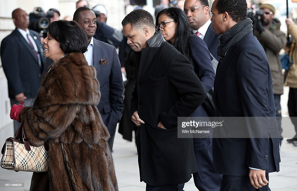 Former Rep. Jesse Jackson Jr., surrounded by family and friends, enters U.S. District Court February 20, 2013 in Washington, DC. Jackson and his wife, Sandi Jackson, are expected to plead guilty to federal charges after being accused of spending more than $750,000 in campaign funds to purchase luxury items, memorabilia and other goods.