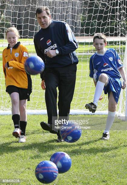 Former Republic of Ireland goalkeeper and technical director of the FAI Packie Bonner joins Roisin O'Mahony and Cian McNevin of the Rush athletic...