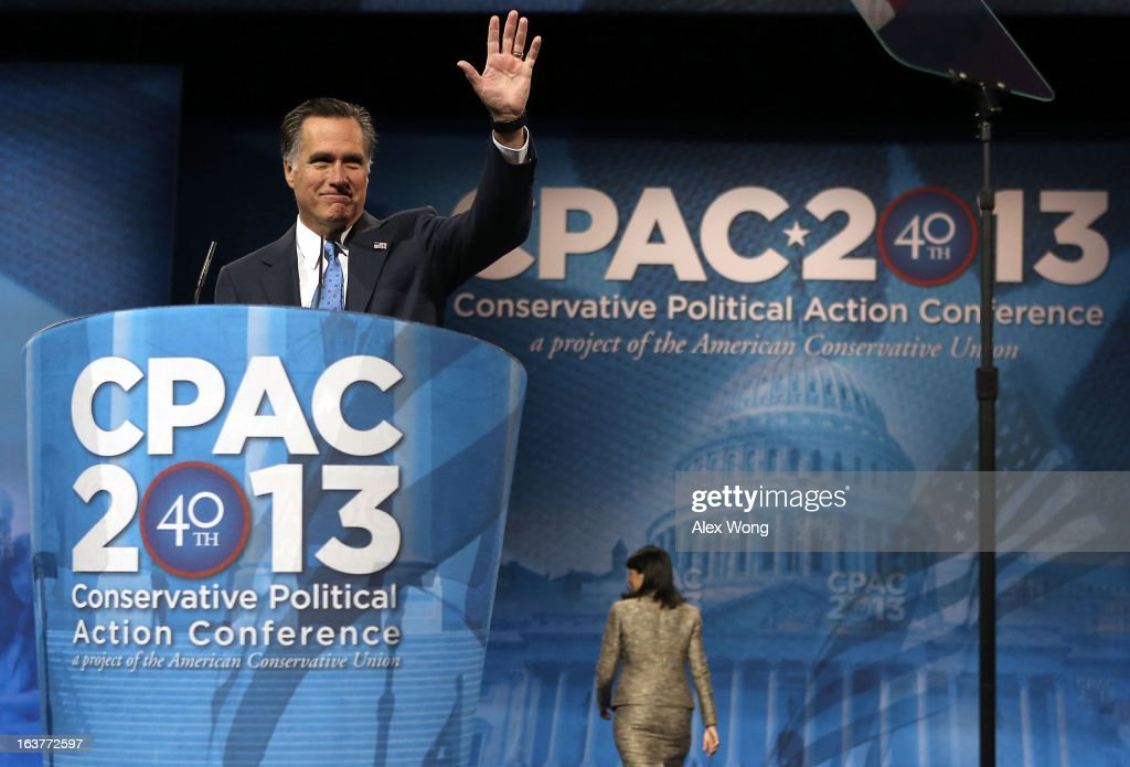 Former Republican presidential candidate and former Massachusetts Governor <a gi-track='captionPersonalityLinkClicked' href=/galleries/search?phrase=Mitt+Romney&family=editorial&specificpeople=207106 ng-click='$event.stopPropagation()'>Mitt Romney</a> (L) acknowledges the crowd after he was introduced by South Carolina Governor <a gi-track='captionPersonalityLinkClicked' href=/galleries/search?phrase=Nikki+Haley+-+Gouverneurin&family=editorial&specificpeople=6974701 ng-click='$event.stopPropagation()'>Nikki Haley</a> during the second day of the 40th annual Conservative Political Action Conference (CPAC) March 15, 2013 in National Harbor, Maryland. The American conservative Union held its annual conference in the suburb of Washington, DC, to rally conservatives and generate ideas.