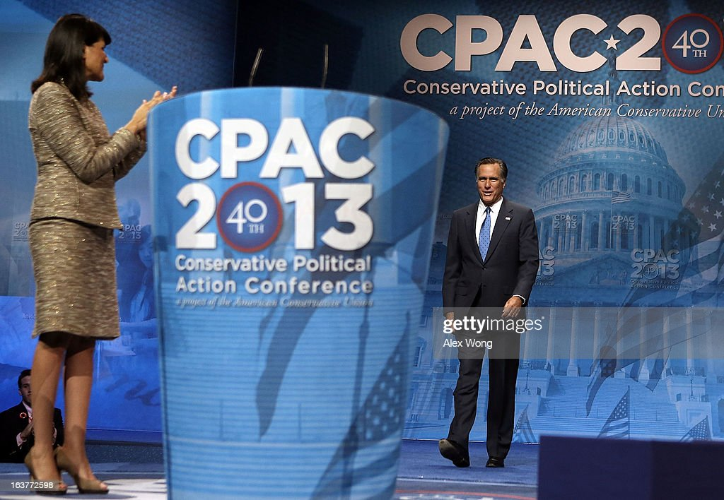 Former Republican presidential candidate and former Massachusetts Governor Mitt Romney (R) is introduced by South Carolina Governor Nikki Haley during the second day of the 40th annual Conservative Political Action Conference (CPAC) March 15, 2013 in National Harbor, Maryland. The American conservative Union held its annual conference in the suburb of Washington, DC, to rally conservatives and generate ideas.