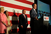 former Republican presidential contender Mitt Romney addresses an audience with Gov Chris Christie during a birthday celebration on September 10 2014...