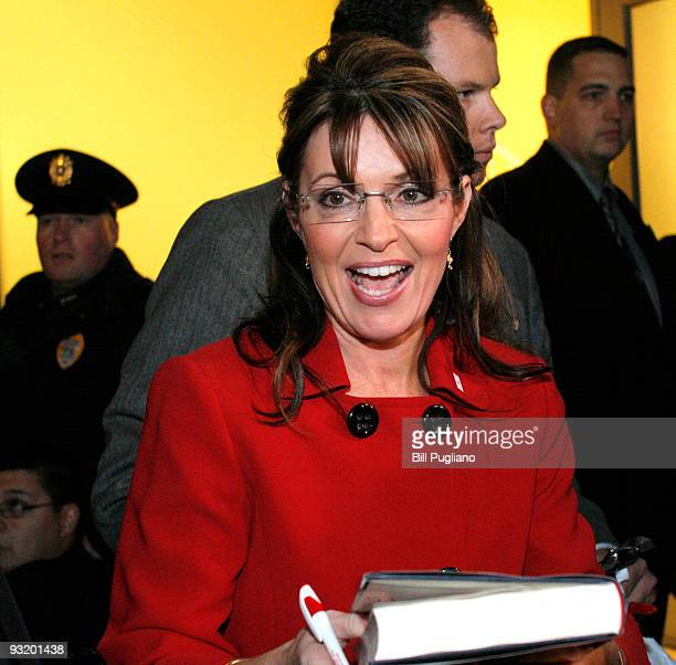 Former Republican vice presidential candidate and Alaska Governor Sarah Palin signs her new book 'Going Rogue' for a customer at a Barnes Noble...