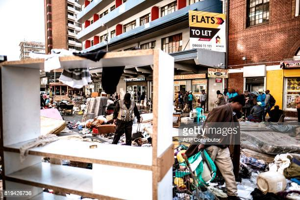 TOPSHOT Former residents of the Fattis Mansion in downtown Johannesburg who were evicted the day before during a Red Ants operation a municipal team...
