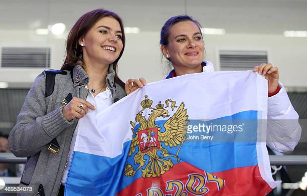 Former rhythmic gymnast Alina Kabayeva and pole vaulter Yelena Isinbayeva of Russia attend the Men's Ice Hockey Preliminary Round Group A game...