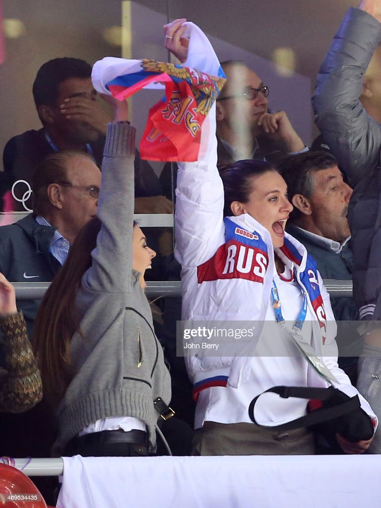 Former rhythmic gymnast Alina Kabayeva and pole vaulter Yelena Isinbayeva of Russia attend the Men's Ice Hockey Preliminary Round Group A game between Russia and USA on day eight of the Sochi 2014 Winter Olympics at Bolshoy Ice Dome on February 15, 2014 in Sochi, Russia.