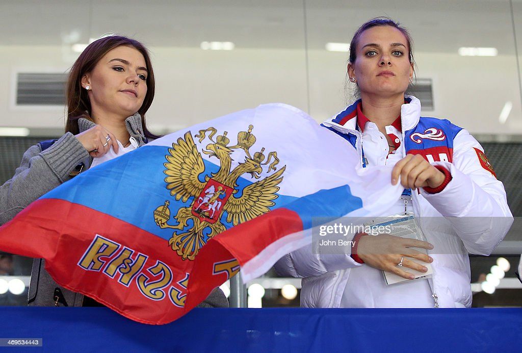 Former rhythmic gymnast Alina Kabayeva and pole vaulter Yelena Isinbayeva of Russia are upset after the Men's Ice Hockey Preliminary Round Group A game between Russia and USA on day eight of the Sochi 2014 Winter Olympics at Bolshoy Ice Dome on February 15, 2014 in Sochi, Russia.