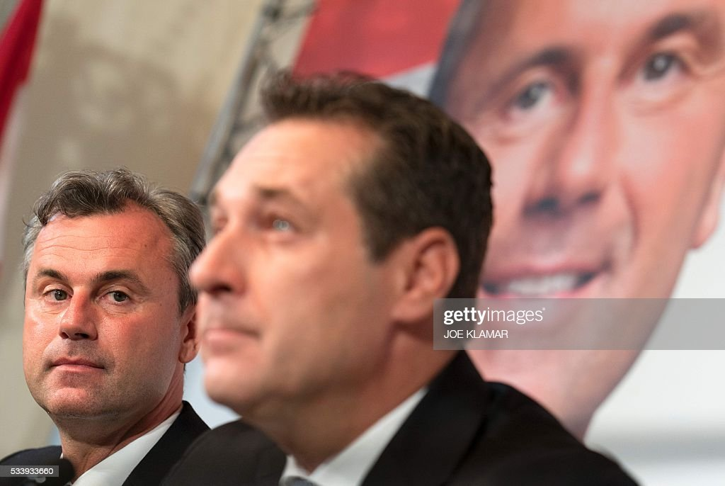 Former right-wing Austrian Freedom Party (FPOe) presidential candidate Norbert Hofer (L) and party leader Heinz Christian Strache (R) attend a news conference in Vienna, Austria, on May 24, 2016. Hofer the previous day was narrowly defeated by Austrian President-elect Alexander Van der Bellen, who had won the presidential elections run-off over Hofer by just a few thousands of votes. / AFP / JOE