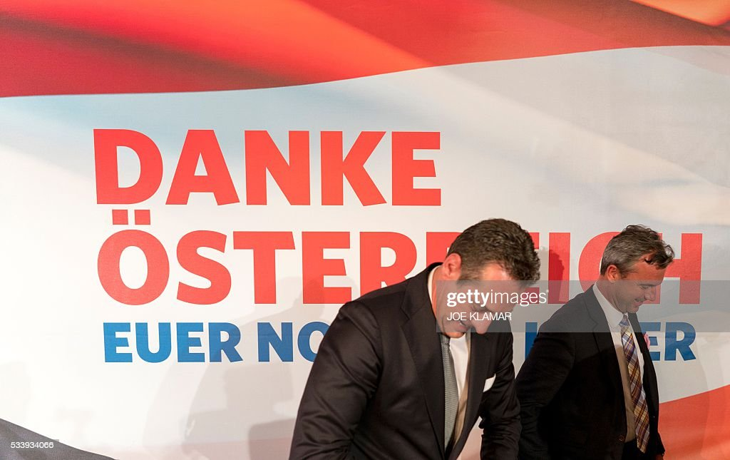 Former right-wing Austrian Freedom Party (FPOe) presidential candidate Norbert Hofer (R) and party leader Heinz Christian Strache (L) leave a news conference in Vienna, Austria, on May 24, 2016. Hofer the previous day was narrowly defeated by Austrian President-elect Alexander Van der Bellen, who had won the presidential elections run-off over Hofer by just a few thousands of votes. / AFP / JOE