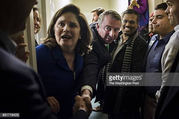 Former RNC chair and White House counselor Ed Gillespie center right greets supporters with his wife Cathy Gillespie center left as he kicks off his...