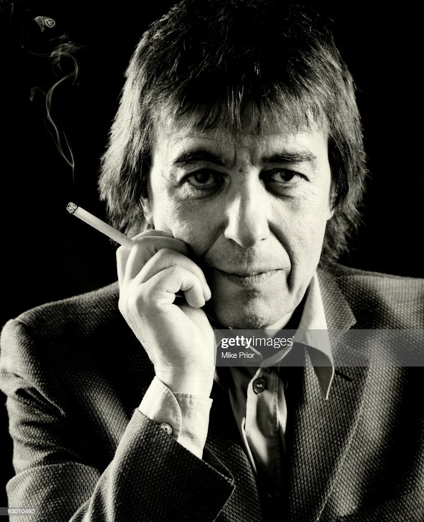 Former Rolling Stones bass player <a gi-track='captionPersonalityLinkClicked' href=/galleries/search?phrase=Bill+Wyman&family=editorial&specificpeople=157859 ng-click='$event.stopPropagation()'>Bill Wyman</a> poses for a studio portrait holding a cigarette c 2001 in London.