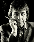 Former Rolling Stones bass player Bill Wyman poses for a studio portrait holding a cigarette c 2001 in London