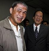 Former Roman Catholic priest Ed Panlilio shares a light moment with Senator Noynoy Aquino son of fomer president Corazon Aquino after a hearing at...