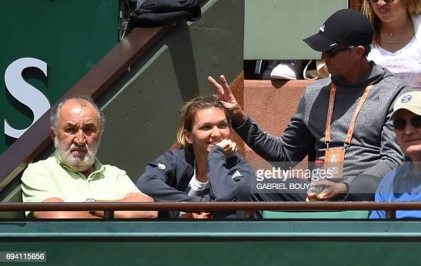 Former Romanian tennis player Ion Tiriac Romania's Simona Halep and her coach Darren Cahill watch the semifinal tennis match between Switzerland's...