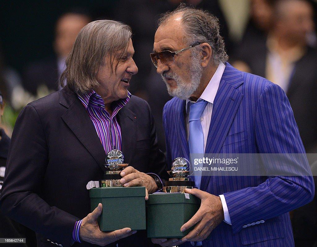 Former Romanian tennis stars Ilie Nastase L and Ion Tiriac R