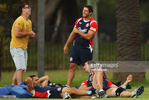 Former Roosters Coach and player Brad Fittler laughs with Anthony Minichello during a Sydney Roosters NRL training session at Kippax Lake on January...