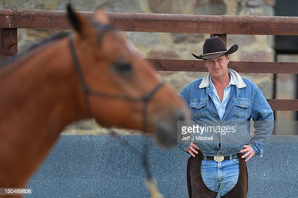 Former Royal Marine Jock Hutchison watches his American Quarter Horse during a course at HorseBack UK on June 28 2012 in Aboyne Scotland Set up by...