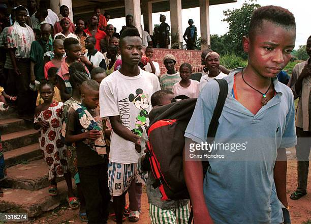Former RUF child soldiers grimly leave a ceremony that turned them over to the United Nations June 4 2001 in the eastern provicial captial of...