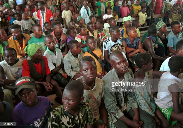 Former RUF child soldiers wait to be turned over to the United Nations June 4 2001 in the eastern provicial captial of Kaliahun Sierra Leone The RUF...