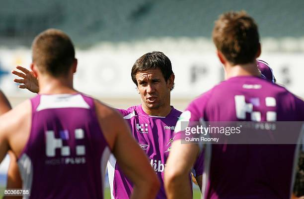 Former rugby league player and now Channel 9 football commentator Matthew Johns speaks to Storm players during a Melbourne Storm NRL training session...
