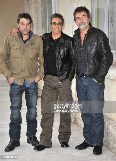 Former Rugby player and Actor Philippe Guillard Actor Gerard Lanvin and Actor Olivier Marchal pose for the photocall of 'Le Fils a Joe' at Hotel...