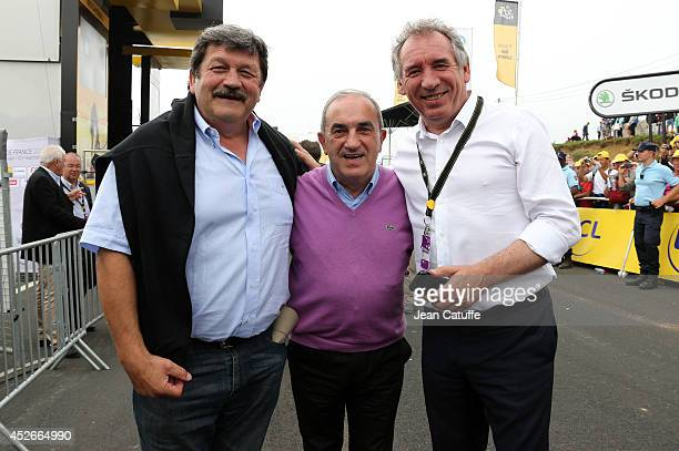 Former rugby player JeanPierre Garuet President of the French Tennis Federation Jean Gachassin and Mayor of Pau Francois Bayrou pose near the finish...