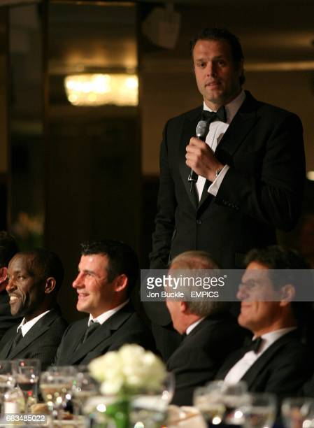 Former rugby player Martin Bayfield speaks as he stands behind PFA Chairman Chris Powell Joe Calzaghe CEO Gordon Taylor and England manager Fabio...