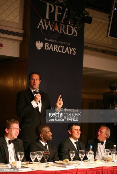 Former rugby player Martin Bayfield speaks as he stands behind PFA Chairman Chris Powell Joe Calzaghe and CEO Gordon Taylor at the PFA Player of the...