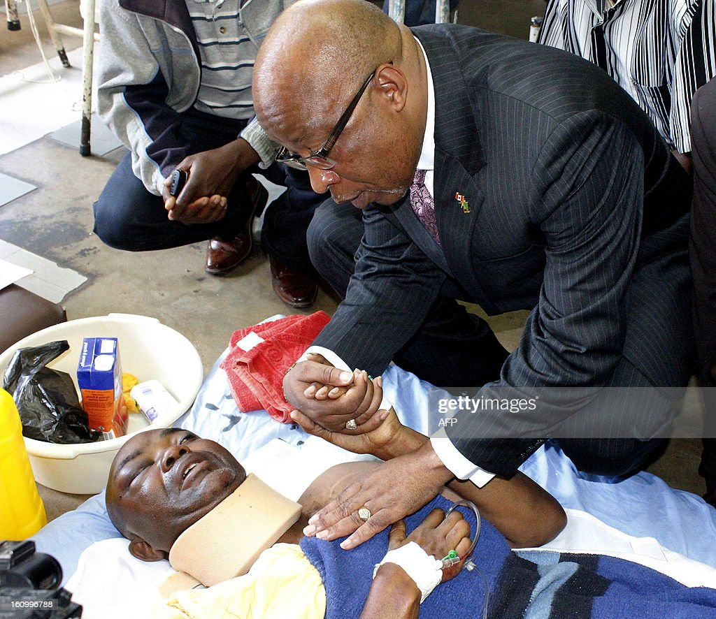 Former ruling party Movement for Multiparty Democracy (MMD) president Nevers Mumba talks to accident survivor 32-year-old Cheelo Hamwete at the University Teaching Hospital in Lusaka on February 8, 2013. Fifty three people were killed in a high-speed collision between a bus and a truck in Zambia on Thursday, the government said, one of the country's worst-ever traffic accidents.