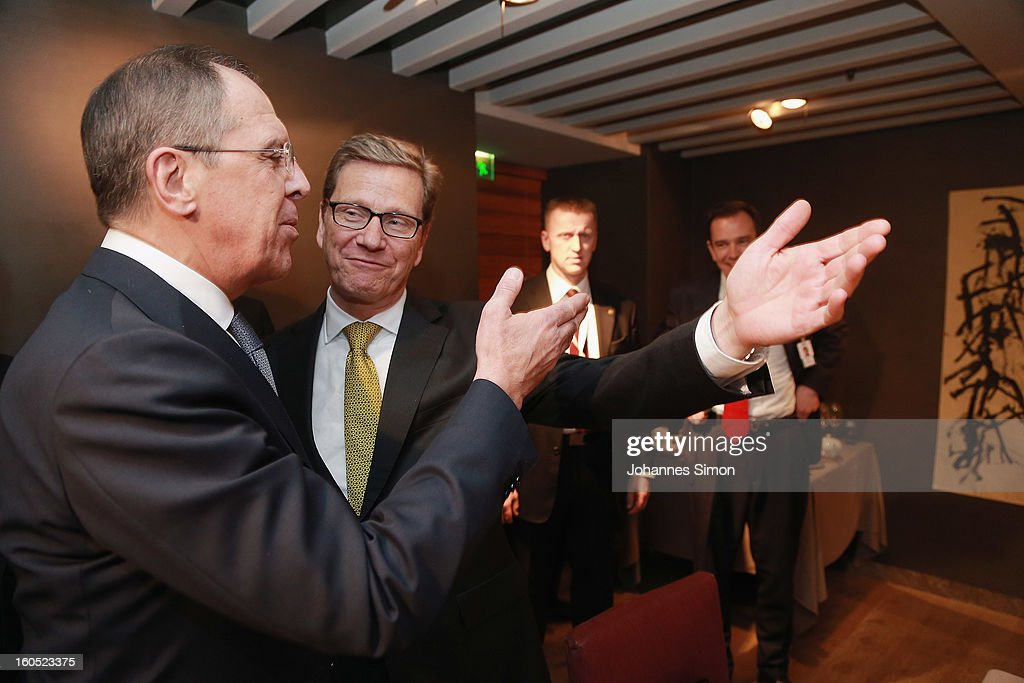 Former Russian minister of foreign affairs Sergey Lavrov (L) and German minister of foreign affairs Guido Westerwelle arrive for a bilateral meeting at Hotel Bayerischer Hof on February 2, 2013 in Munich, Germany. The Munich Security Conference brings together senior figures from around the world to engage in an intensive debate on current and future security challenges and remains the most important independent forum for the exchange of views by international security policy decision-makers.