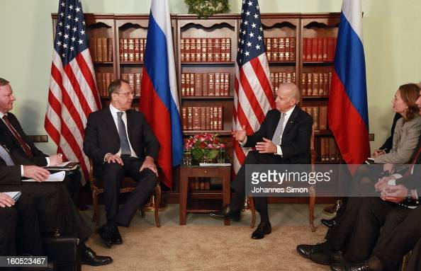 Former Russian minister of foreign affairs Sergey Lavrov and US vice president Joe Biden attend a bilateral meeting at Hotel Bayerischer Hof on...