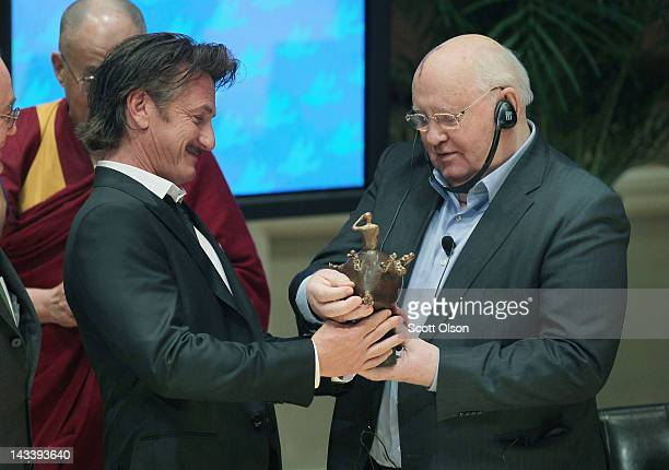 Former Russian President Mikhail Gorbachev presents actor and philanthropist Sean Penn with the 2012 Peace Summit Award during the World Summit of...