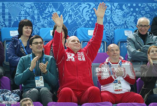 Former Russian swimmer Alexander Popov and former grecoroman wrestler Alexander Karelin and George Bryusov attend the Figure Skating Pairs Short...
