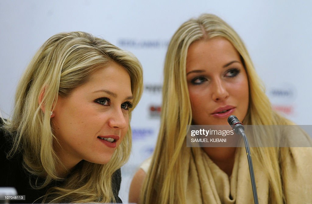 Former Russian tennis player Anna Kurnikova (L) talks with Slovak tennis player Dominika Cibulkova (R) during press conference on November 21,2010 in Bratislava. Kurnikova with Austria's tennis player Thomas Muster will play a charity exhibition match against Slovak players Dominik Hrbaty and Cibulkova in Bratislava's tennis arena on November 22.
