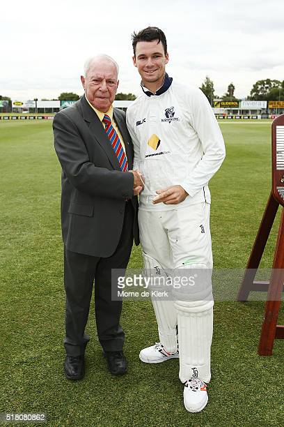 Former SA cricketer Neil Dansie presents Peter Handscomb of the VIC Bushrangers with his award for ManoftheMatch after play on day 5 of the Sheffield...
