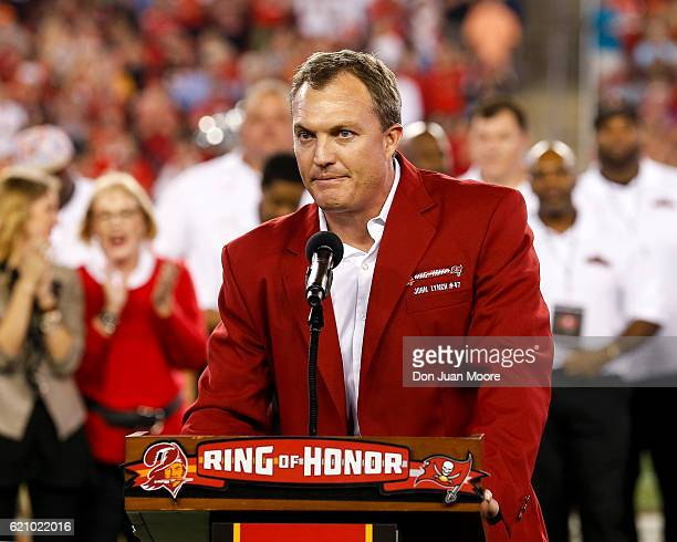 Former Safety John Lynch of the Tampa Bay Buccaneers address the fans during his induction in the team's Ring of Honor during halftime of the game...
