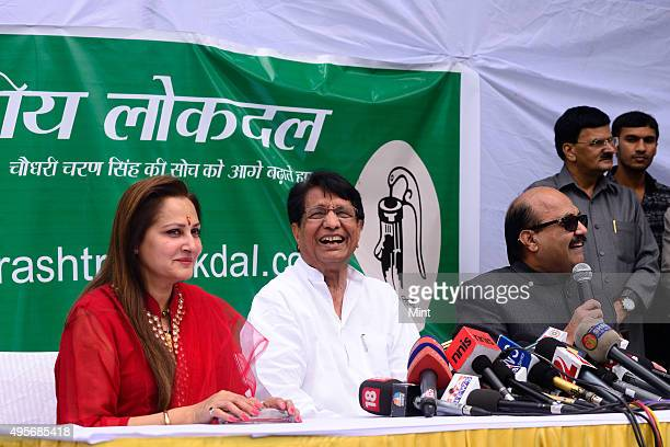 Former Samajwadi leaders Amar Singh Jaya Prada join Rashtriya Lok Dal in the presence of party President Ajit Singh on March 10 2014 in New Delhi...