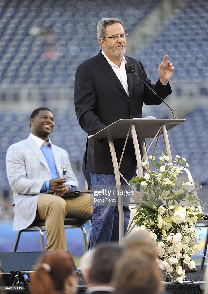Former San Diego Chargers quarterback <a gi-track='captionPersonalityLinkClicked' href=/galleries/search?phrase=Dan+Fouts&family=editorial&specificpeople=228594 ng-click='$event.stopPropagation()'>Dan Fouts</a> speaks as <a gi-track='captionPersonalityLinkClicked' href=/galleries/search?phrase=LaDainian+Tomlinson&family=editorial&specificpeople=201548 ng-click='$event.stopPropagation()'>LaDainian Tomlinson</a> (L) looks on during a memorial for former San Diego Chargers star football player Junior Seau at Qualcomm Stadium May 11, 2012 in San Diego, California. Seau was found shot to death at his home in what police way was a suicide.