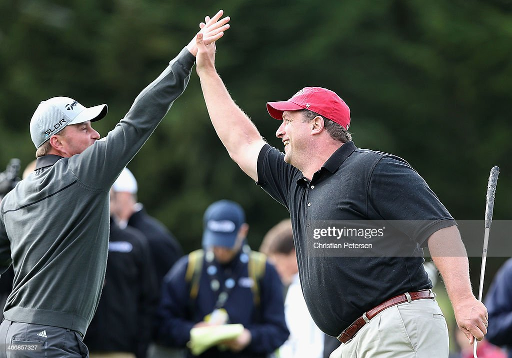 Former San Francisco 49ers tight end, Brent Jones (R) high-fives <a gi-track='captionPersonalityLinkClicked' href=/galleries/search?phrase=Matt+Bettencourt&family=editorial&specificpeople=4681547 ng-click='$event.stopPropagation()'>Matt Bettencourt</a> (L) after winning the second hole during the 4th Annual Chevron Charity Shoot-Out ahead of the AT&T Pebble Beach National Pro-Am at Pebble Beach Golf Links on February 4, 2014 in Pebble Beach, California.