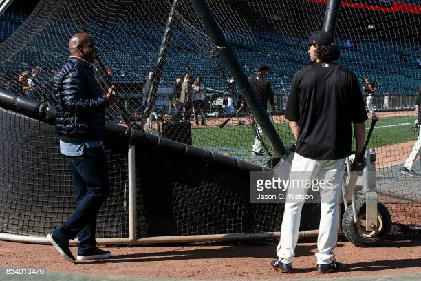 Former San Francisco Giants outfielder Barry Bonds talks to Jarrett Parker during batting practice before the game against the Chicago Cubs at ATT...