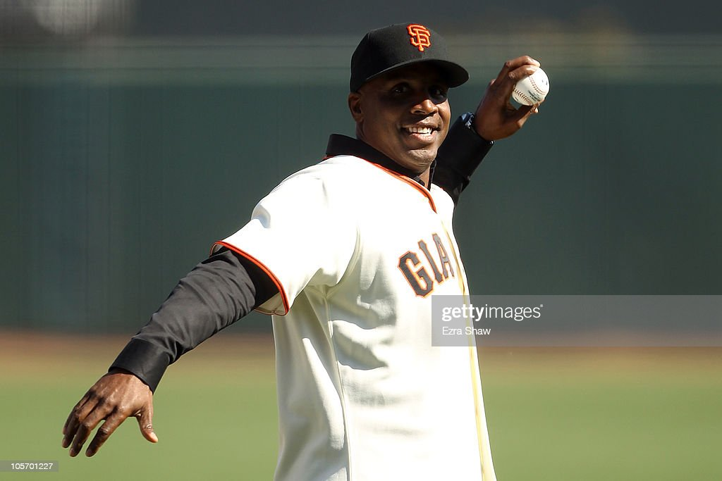 Former San Francisco Giants outfielder Barry Bonds throws out the first pitch prior to Game Three of the NLCS against the San Francisco Giants during the 2010 MLB Playoffs at AT&T Park on October 19, 2010 in San Francisco, California.