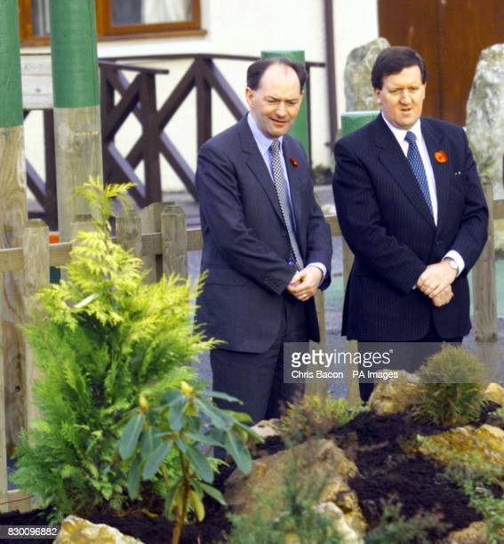 Former Scottish Secretary Sir Michael Forsyth with Defence Secretary George Robertson at Dunblane Primary School in a garden where the old gymnasium...