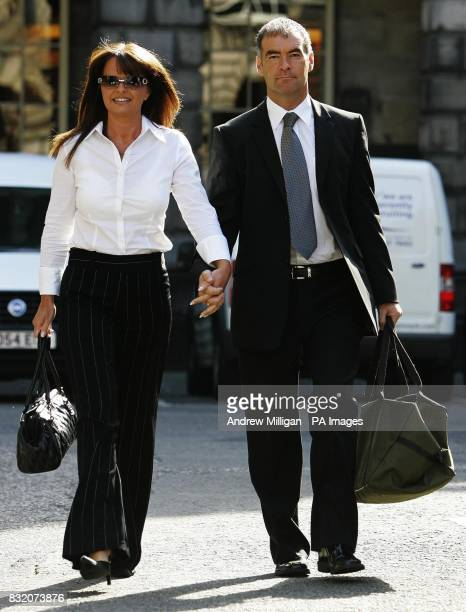 Former Scottish Socialist leader Tommy Sheridan arrives at the Court of Session in Edinburgh with his wife Gail for his ongoing 200000 defamation...