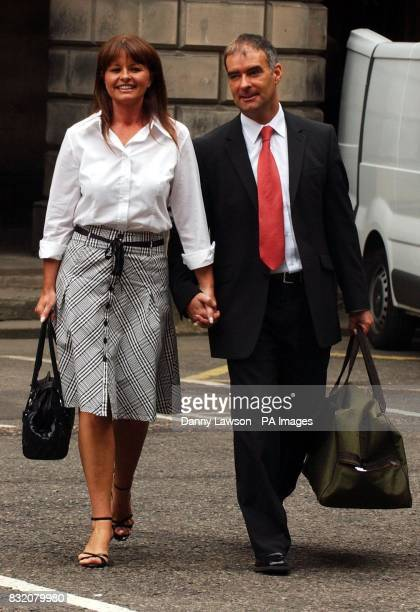 Former Scottish Socialist leader Tommy Sheridan leaves the Court of Session in Edinburgh with his wife Gail as his ongoing 200000 defamation action...