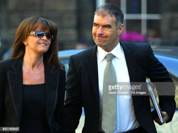 Former Scottish Socialist Party leader Tommy Sheridan arrives with wife Gail at the Court of Session in Edinburgh where his defamation action against...