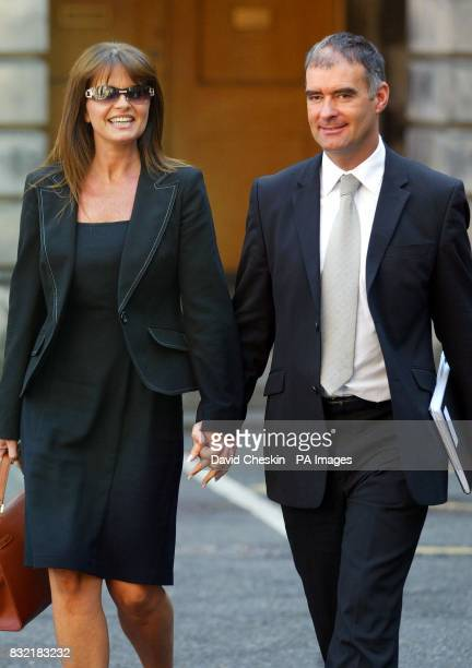 Former Scottish Socialist Party leader Tommy Sheridan leaves the Court of Session in Edinburgh with his wife Gail as his defamation action against...
