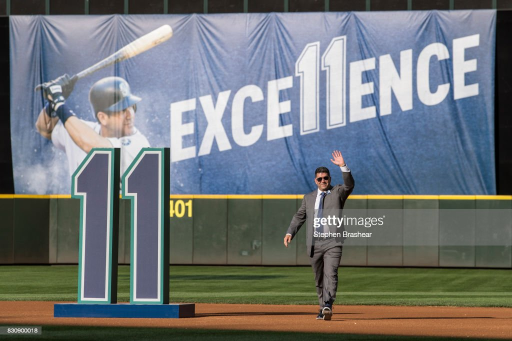 Former Seattle Mariner and current hitting coach Edgar Martinez acknowledges the crowd as he walks out during a ceremony to retire his number before a game between the Los Angeles Angels of Anaheim and the Seattle Mariners at Safeco Field on August 12, 2017 in Seattle, Washington.