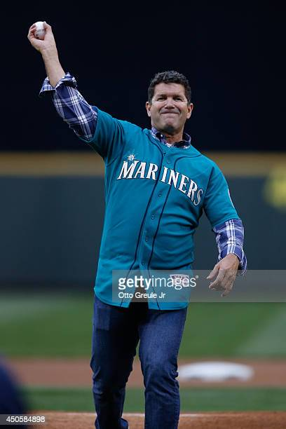 Former Seattle Mariner Edgar Martinez throws out the ceremonial first pitch prior to the game between the Seattle Mariners and the Texas Rangers at...