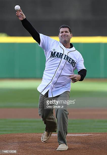 Former Seattle Mariners great Edgar Martinez throws out the ceremonial first pitch prior to the game between the Seattle Mariners and the Los Angeles...